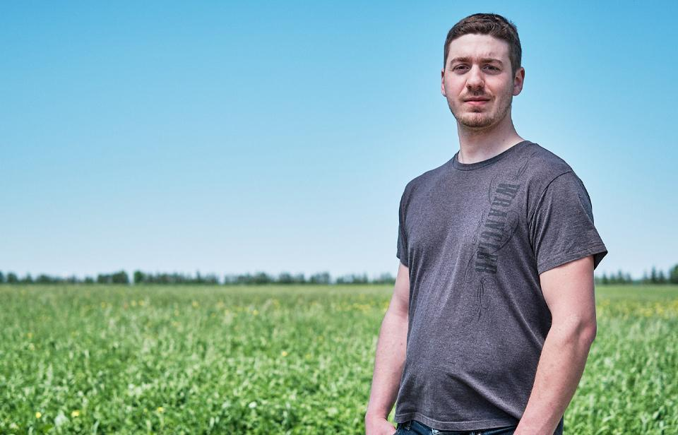 A Canadian dairy farmer in a field