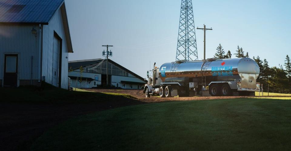 A Dairy Farmes of Canada milk truck arrives at a Canadian farm