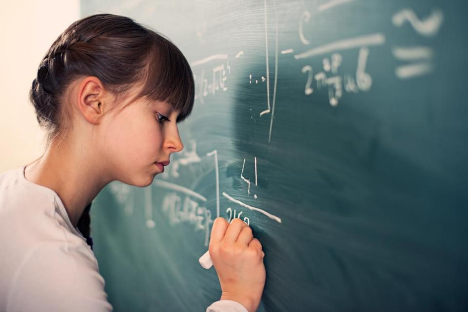 Young girl solving a mathematical problem