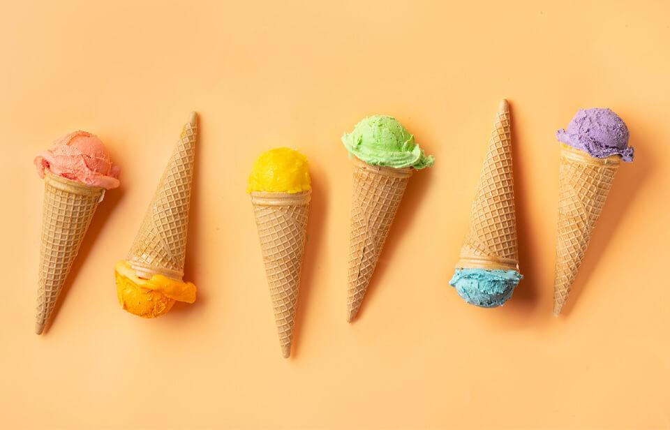 Various ice cream cones on a yellow background