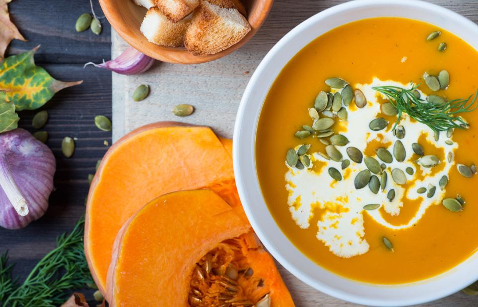 Pumpkin soup drizzled with cream