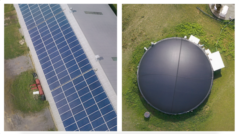 Aerial shot of a solar panel array and a biodigester on a Canadian dairy farm