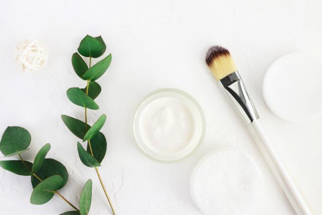 Homemade moisturizing face mask in a jar next to a brush