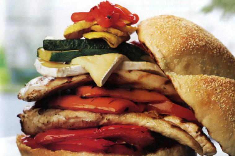 chicken burger with grilled vegetables and brie