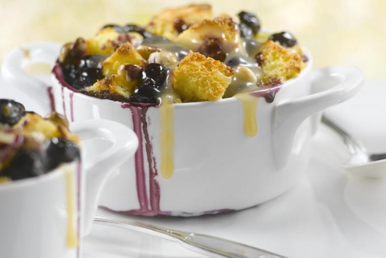 new brunswick blueberry lemon and white chocolate bread pudding with maple cream sauce