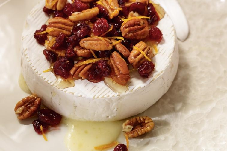 Baked brie topped with cranberries and pecans