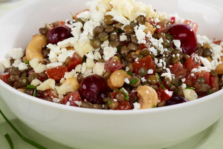 warm lentil tomato salad with cherries and cashews
